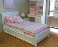 Copenhagen Trundle Bed is made from pine and finished in low gloss white finish. The frame features a sleigh style headboard with rounded top.