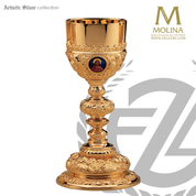 10 ounce Baroque chalice stands 9 and 1 quarter inches high with 3 medallions made of sterling with gold plate finish includes a paten made in spain by artistic silver as2502cpss