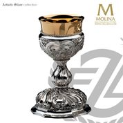 13 ounce Baroque chalice stands 7 and 3 quarters inches high with relief angels in choice of 2 compositions includes a paten made in spain by artistic silver AS2915