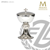 stainless steel covered ciborium with  ornate accent node stands 7 and 7 eighths inches high with gold bowl lining made in Spain by Molina AS5366cbstsgl