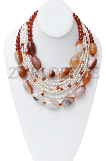 Handamde unique orange and white jewelry. Made with carnelian barrel beads, rice fresh water pearls and carnelian faceted beads