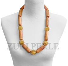 Handmade unique Peach Coral jewelry, made with peach coral tube beads and handwoven crystal gold balls