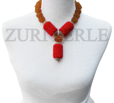 Handmade unique coral jewelry, made with handwoven orange coral tube beads accented gold crystal clusters