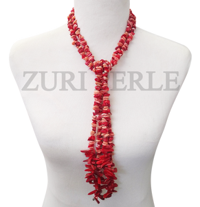Handmade red and peach tassel necklace, made with red coral, peach coral chips and red coral sticks.