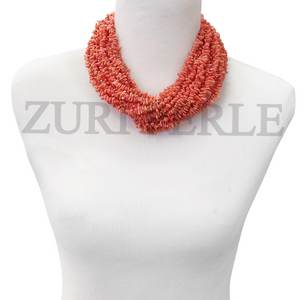 Chic, coral chip statement necklace designed and handmade at the Zuri Perle Studio in Missouri, U.S.A