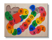 Alphabet ABC Wooden Puzzle with a few pieces out. Please notice the lower case letters under each capital letter piece.