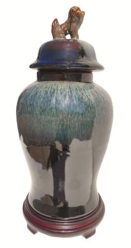 Chinese porcelain jar with lion lid handle jar.  Black drip glaze.