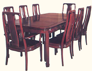 44 inch round rosewood dining room set with two leaves, 8 chairs and 2 18-inch leaves.