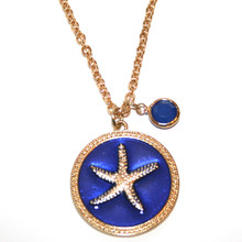 Gold Tone Starfish on a Royal Blue Enamel Disk with Gold Tone Link Necklace
