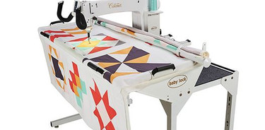 "The new Baby Lock Coronet longarm quilting machine opens up worlds of possibilities for first-time longarm quilters. The included 5' frame that fits easily into the smallest studio, yet the Coronet has a huge 16"" workspace that gives quilters complete control over their compositions from beginning to end."