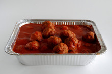 Meatballs in sauce in a pan.
