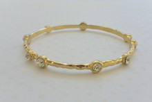 Woven Bangle With Rhinestones and Diamond Cut Gold Tone Finish