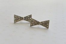 Bow Tie Stud Earrings with Sparkling Rhinestones in Silver Tone