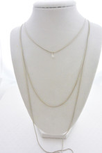 Three Layer Necklace with a Floating Brilliant Cubic Zirconia Stone in Silver