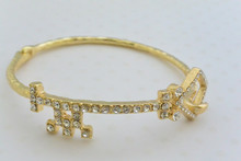 Rhinestone Key Bangle Gold Tone