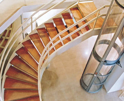 A sharp view of the PVE30 Model installed next to curved stairs.