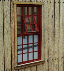 Engine shed window with an industrial look.  framing is on both sides.