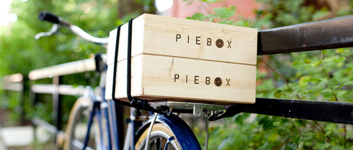 two pie boxes on a bike