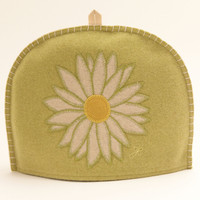 Daisy tea cosy, green, yellow and cream wool, hand-embroidered