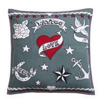 Designer hand-embroidered Love Tattoo wool cushion with anchor, hearts and stars.