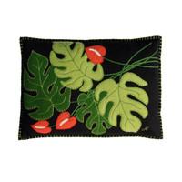 Designer black, green and orange designer cheese plant cushion. Tropical house plants.