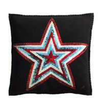 Red, white and turquoise blue sequin star cushion, exquisitely hand embroidered onto black wool felt.