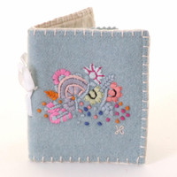 Pale blue needle case with flowers