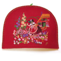 Multi-coloured flowers, garden tea cosy, red wool, hand-embroidered