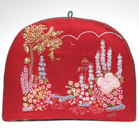 Red felt garden tea cosy