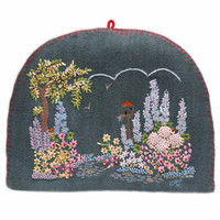 Grey felt garden tea cosy