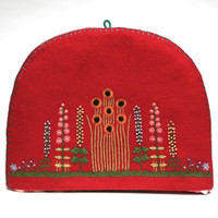 Red felt flowers and trees tea cosy