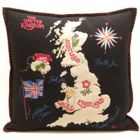 British Isles map cushion, black wool, hand-embroidered