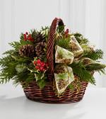 Christmas Coziness™ Bouquet is an expression of holiday homecoming and heartfelt cheer. Assorted holiday greens, variegated holly, natural pinecones, red berry pics, and cinnamon sticks are lovingly arranged in a dark brown bamboo basket accented with an ivory holiday ribbon to create a seasonal sentiment of peace and goodwill.
