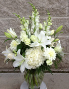 White flowers in all varieties and shapes. Let Hatcher Florist help you express your feelings with this vase of white snapdragons, asiatic lilies, hydrangea, lisianthus and dahlias. We will make one up fresh for you in our Toronto-North York flower shop.