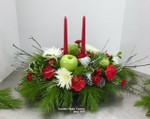 Oblong centrepiece created by Collin at Hatcher Florist. seasonal fresh pine and balsam from Apsley,ON. Green apples and red carnations with sliver stems and dogwood, festive bow, mums and carnations. Light the candle with the Christmas meal. Created fresh daily in our Toronto, North York flower shop.