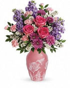 Send her love, bring her joy! Delivering flowers from our Toronto flower shop. This bright, beautiful blend of pink and lavender blooms is hand-delivered in a hand-glazed keepsake vase that's adorned with a graceful low-relief motif. A gift that will forever remind her of your thoughtfulness, on Mother's Day and all year long! This delightful bouquet includes hot pink roses, pink miniature carnations, lavender stock, lavender cushion spray chrysanthemums, white sinuata statice, and huckleberry. Delivered in Teleflora's limited edition Love And Joy vase. Orientation: One-Sided