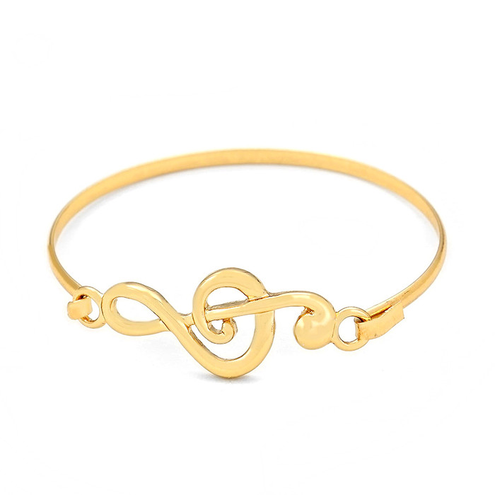 golden treble clef bangle