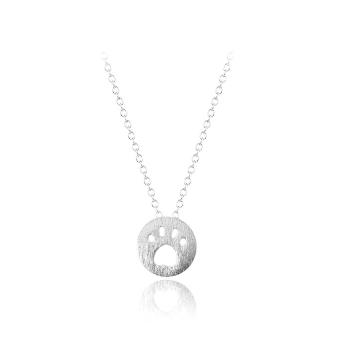 silver mini paw print necklace with brushed texture