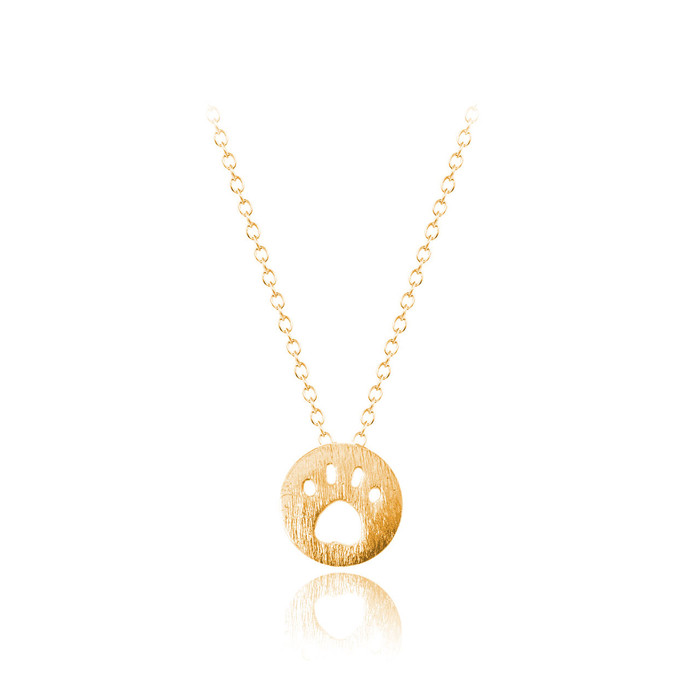 golden mini paw print necklace with brushed texture