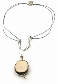 Eco-chic Ivory Tagua slice on a silver plated field.