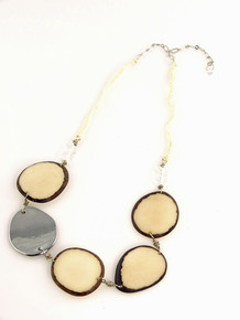 Eco-chic Ivory Tagua slices with an accented metal chrome accent.