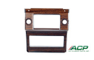 1969-1970 Ford Mustang radio bezel.  Woodgrain decals for deluxe interior.