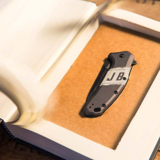 Folding knife concealed in a hollowed out book.