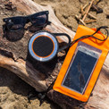 All you need to spend the day at the beach; waterproof phone sleeve, bluetooth speaker, and floating sunglasses