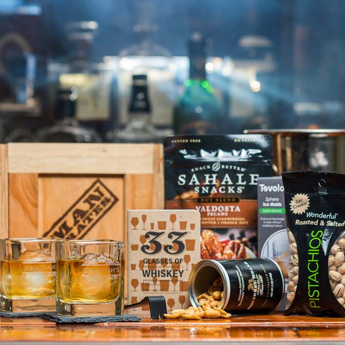 Every man is one step of refinement away from swapping charming anecdotes at a foreign diplomat's dinner party. This personalized whiskey crate is that step.