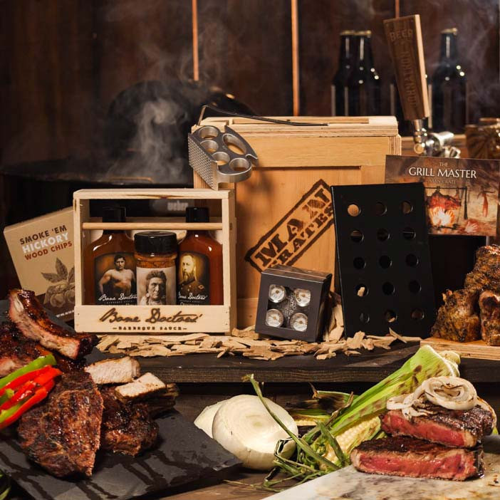 It's a three-hit combo- a brass knuckle meat tenderizer to soften up the meat, the hickory smoker box for extra deep flavor penetration, and pro-style thermometers to pull the steaks off at exactly the right moment.