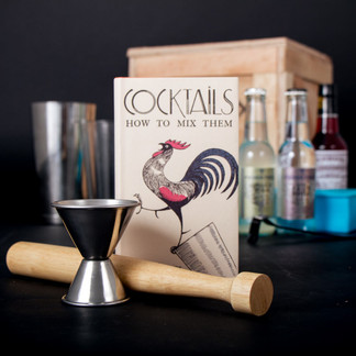 Arm yourself with Robert's revised 1922 guide Cocktails: How to Mix Them. Choose a standalone spirit worthy to drink on it's own, a classic recipe, and take a smug seat at the intersection of freedom* and good taste.