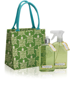 Green canvas tote printed with turtles with bottles of kitchen cleaner and dish soap
