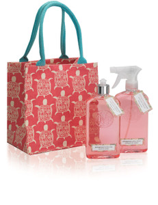 Pink canvas tote with pink bottles of kitchen cleaner and dish soap