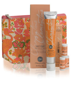 Orange block printed canvas cosmetic bag with orange lotion tube and mini lip balms